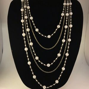 Gold tone long pearl necklace